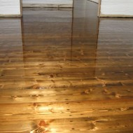 Old and relaid Baltic Pine, stained with gloss finish